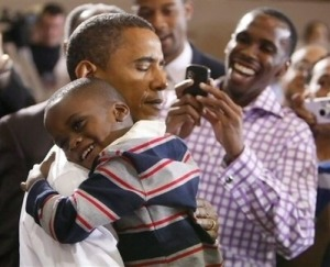 A kid gets a hug from Barack